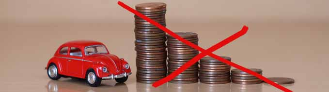 Ankara, Turkey - September 6 2020: Concept of car prices or taxes with close up coins and red toy car.