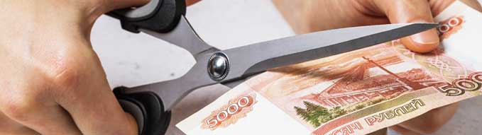 A man cuts five thousand Russian rubles. Concept on the topic of devaluation of money in the country