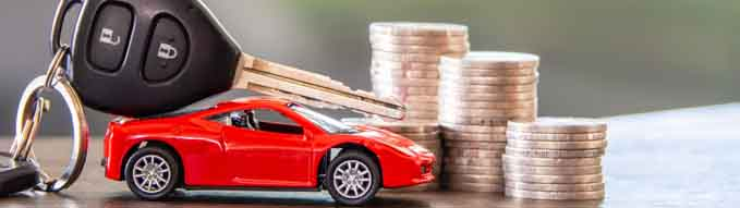 red car  and key on stacks of coin,  car loan concept,  Saving money for car concept,  trade car for cash concept, finance concept.
